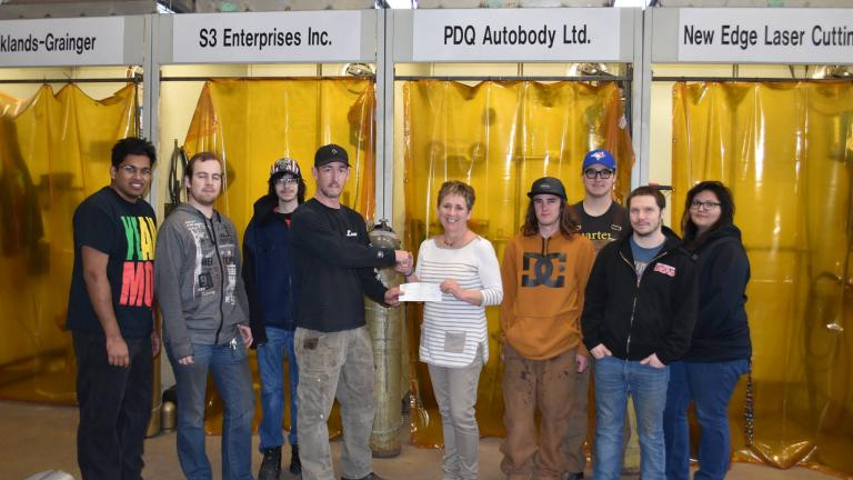 Presentation of cheque to welding students