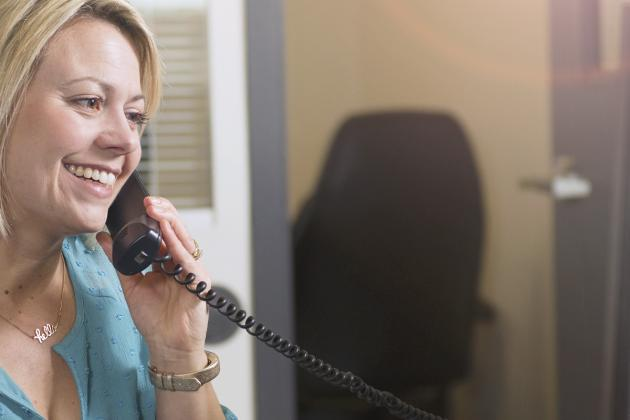 Smiling woman taking a phone call